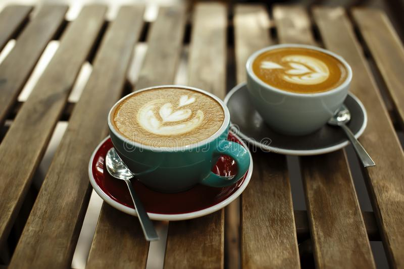 Two cup of coffee on wooden background. Breakfast morning concept in cafe stock image