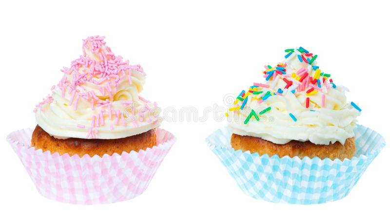 Two cupcakes with whipped cream decorated sprinkles isolated on white background royalty free stock photo