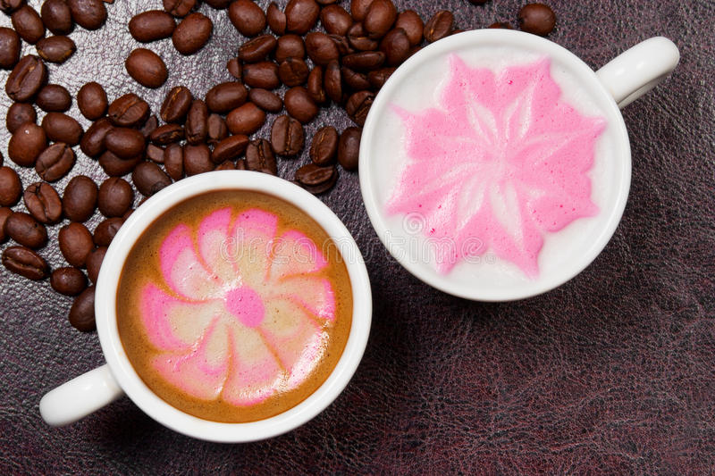 Two cups of beautiful coffee art cappuccino royalty free stock photos