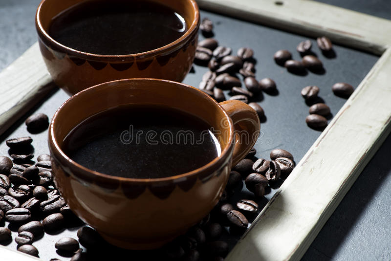 Two cups of black coffee on the blackboard royalty free stock photos