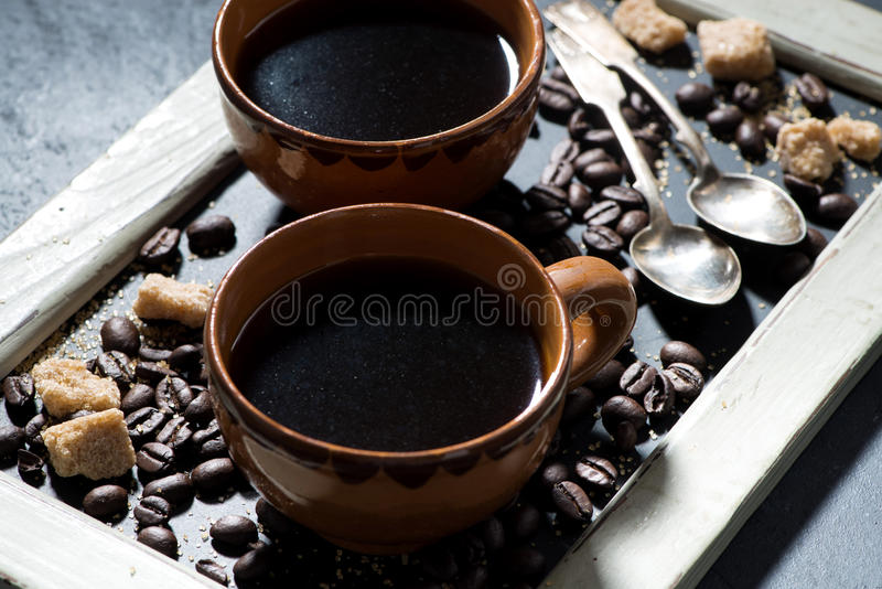 Two cups of black coffee on the blackboard, closeup royalty free stock images