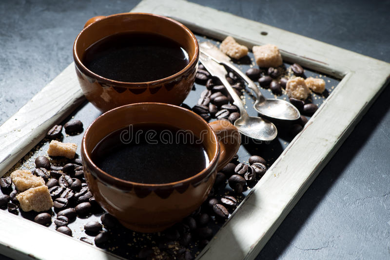 Two cups of black coffee and sugar on the blackboard stock images