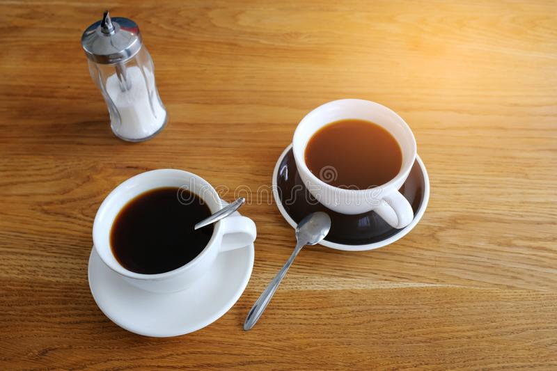 Two cups of black coffee on a wooden table, morning coffee. Business breakfast. Coffee break. Business meeting. The businessmen`s royalty free stock photo