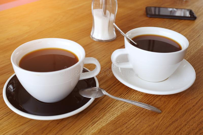 Two cups of black cofffee on wood table, morning coffee. Clouse-up stock photos