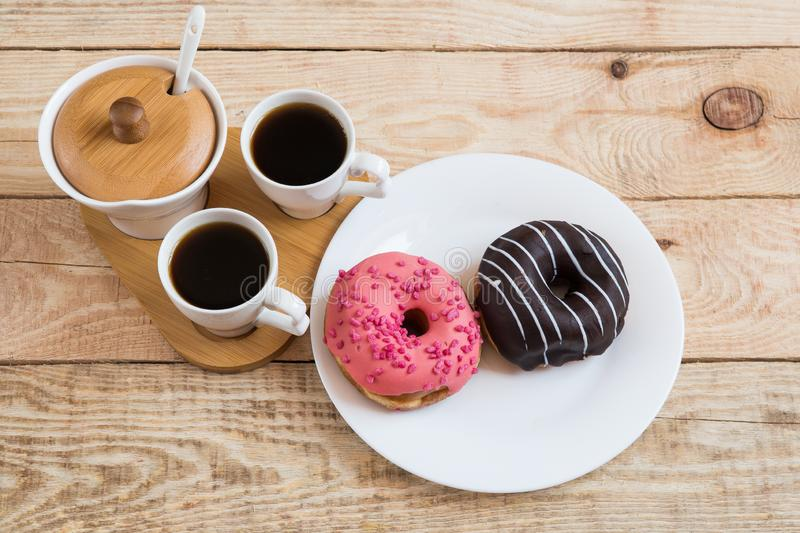 Two cups of coffee Cherry Chocolate doughnut donut stock images