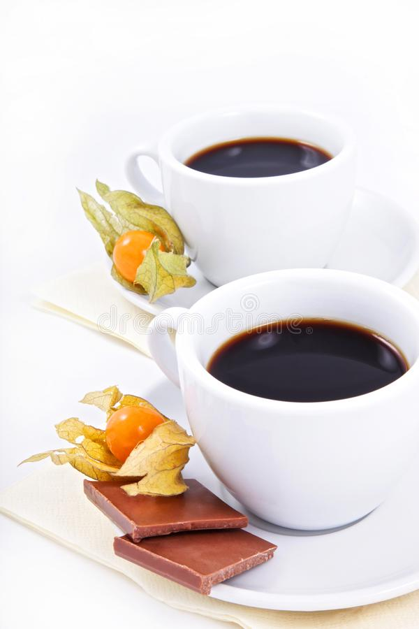 Two cups of coffee with chocolate