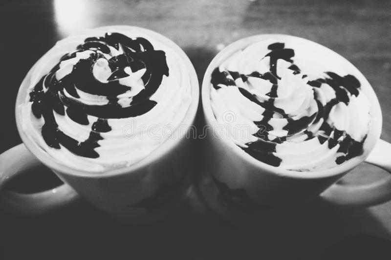 Two cups of coffee. Two shapes, two ways, two attitudes stock photo