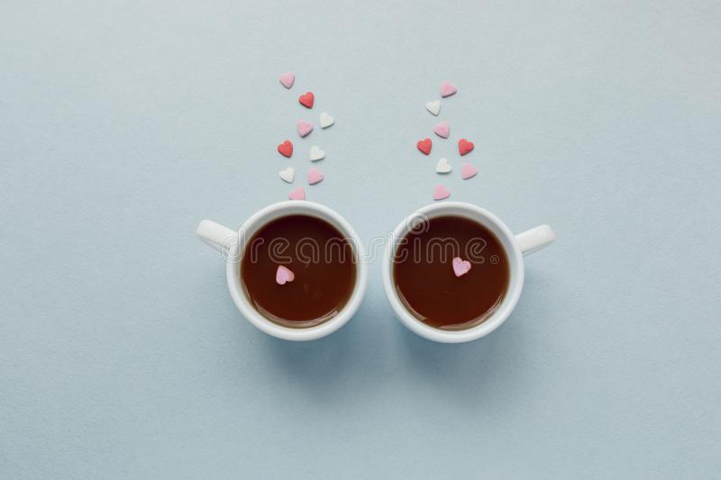 Two cups of coffee with sugar hearts. Love concept. stock images
