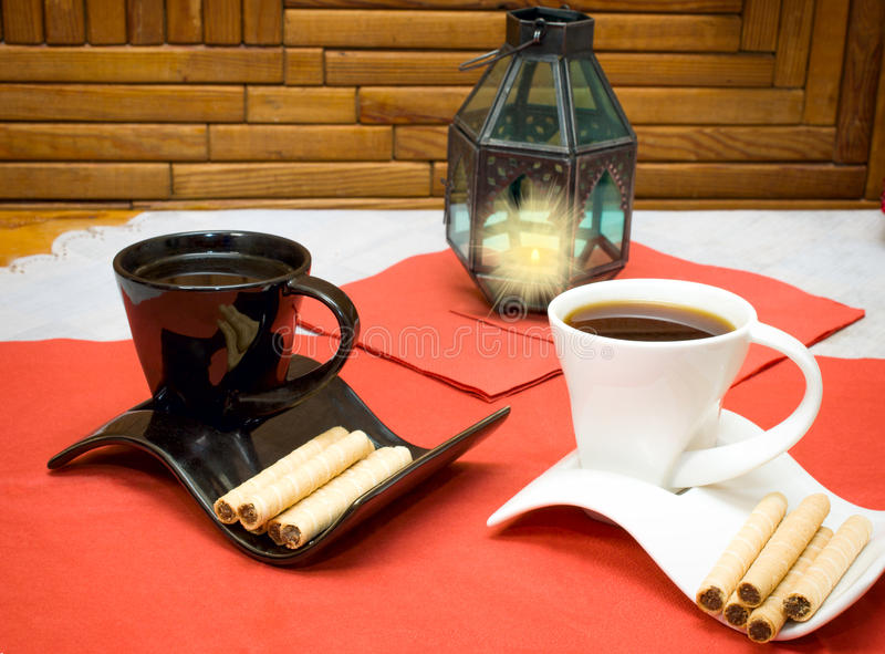 Two cups of coffee and wafer sticks with chocolate stock photography