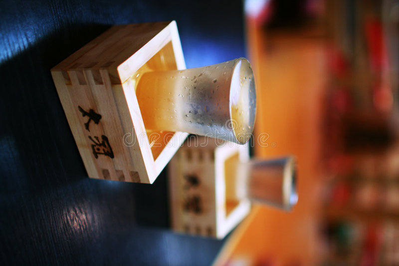 Two cups filled with sake royalty free stock images