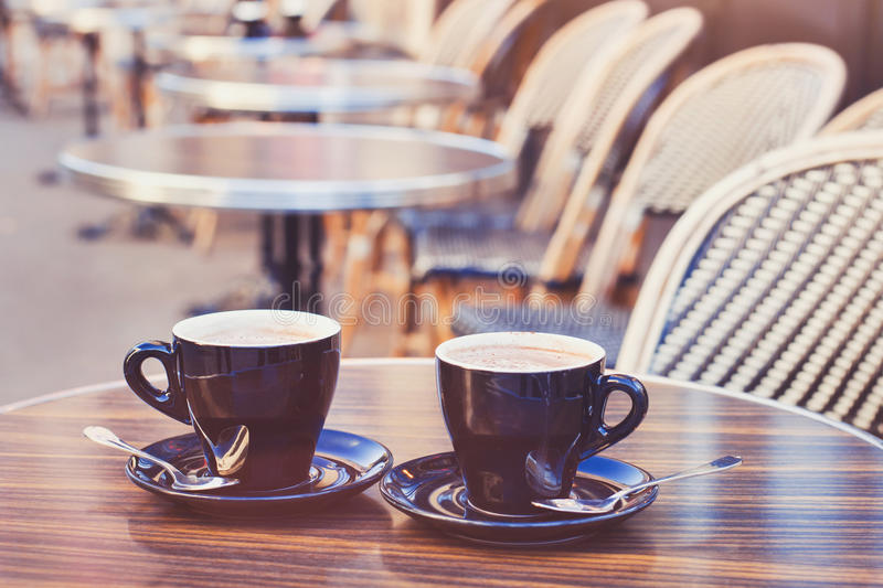 Two cups of hot chocolate or coffee cappuccino royalty free stock images
