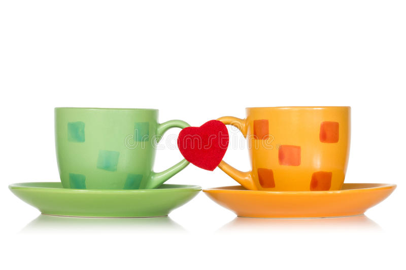 Two cups with red heart stock photo