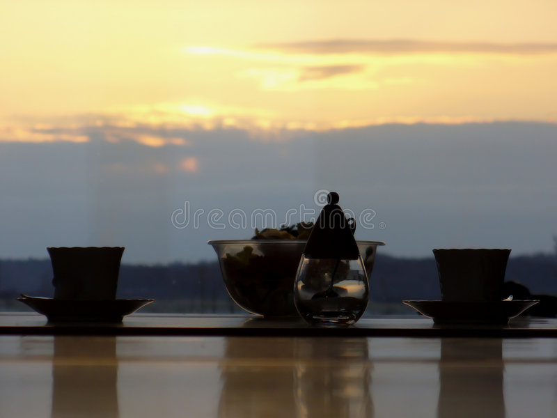 Two cups of tea in the sunset stock photos