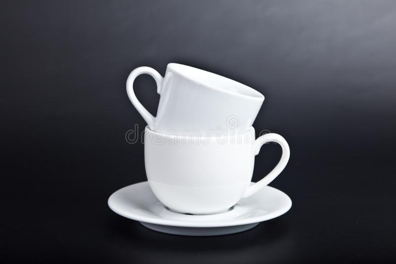 Two cups of white on  black royalty free stock images