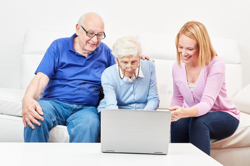 Two curious seniors in a computer class stock photography