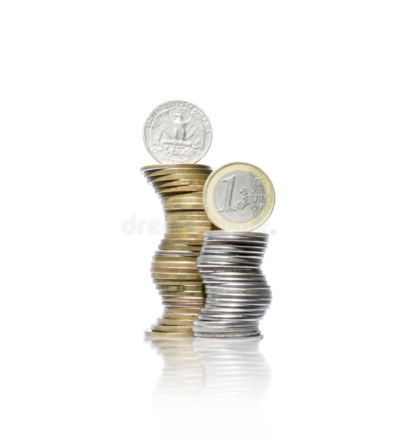Two curved piles of yellow and white metal coins with quarter do. Photo of two curved piles of yellow and white metal coins with quarter dollar and one euro on stock photos
