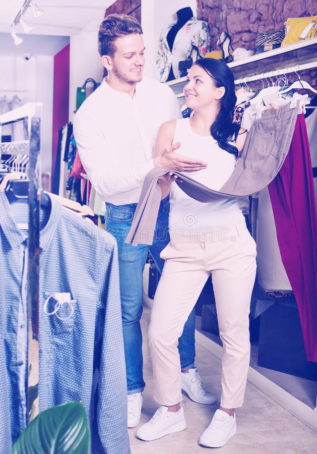 Download Two Customers Selecting Jeans Stock Photo - Image: 83701860