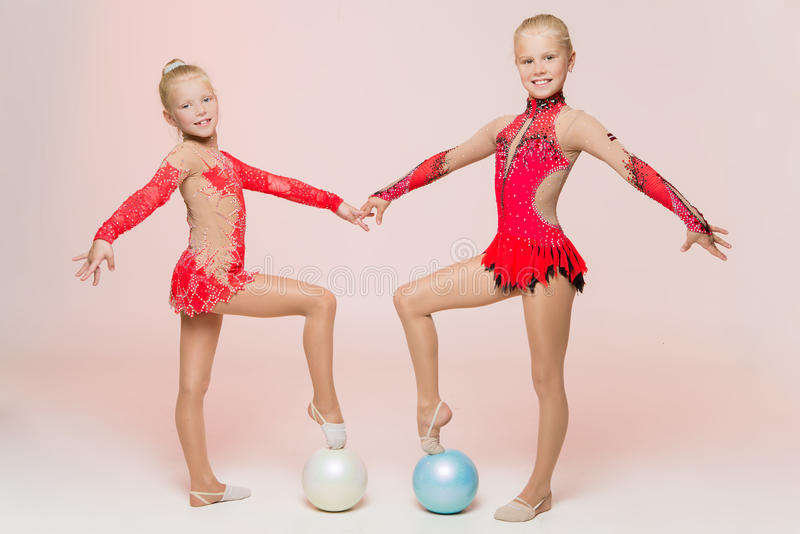 Two cute artistic gymnasts stock image