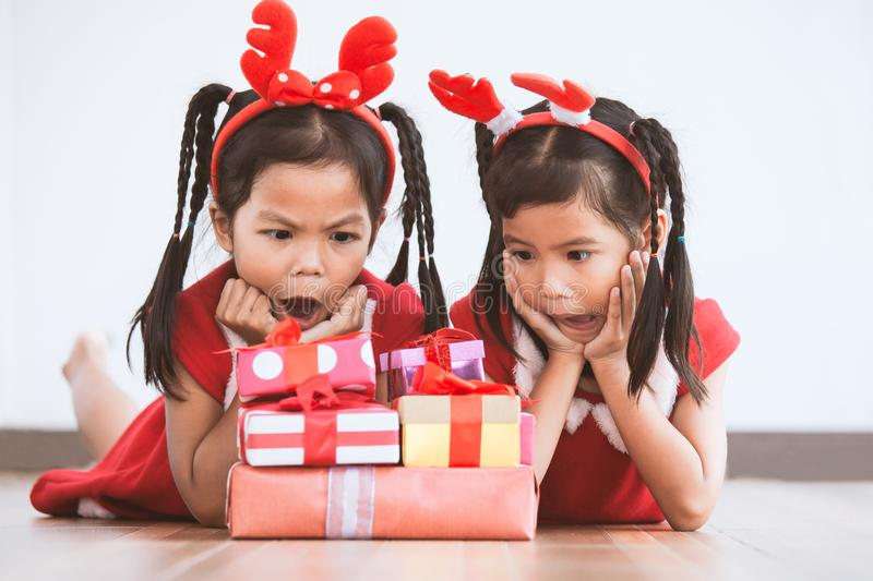 Two cute asian child girls surprise with gift boxes stock images