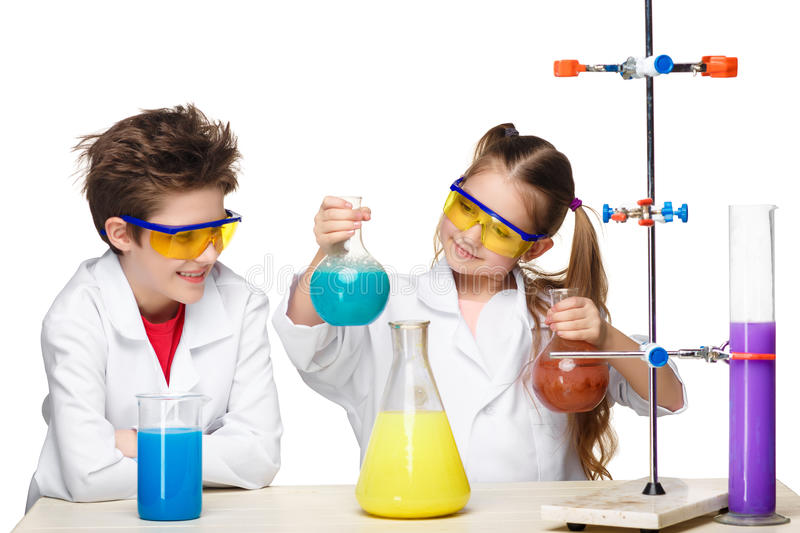 Two cute children at chemistry lesson making royalty free stock photography