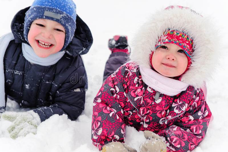 Two cute children playing in winter stock image