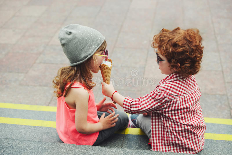 Two cute hipsters eating icecream royalty free stock photos