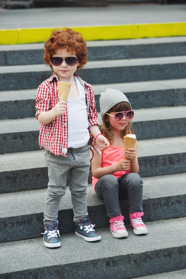 Two cute hipsters eating icecream stock photography