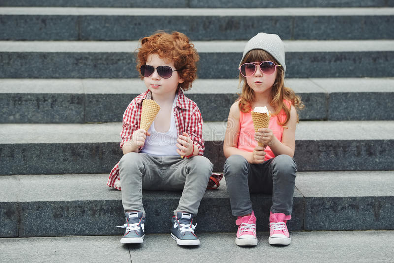Two cute hipsters eating icecream royalty free stock images