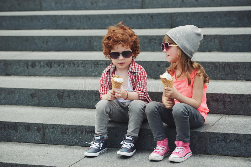 Two cute hipsters eating icecream stock images
