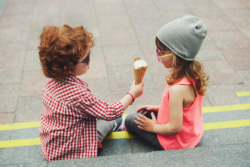 Two cute hipsters eating icecream. Photo of two cute hipsters eating icecream stock photos