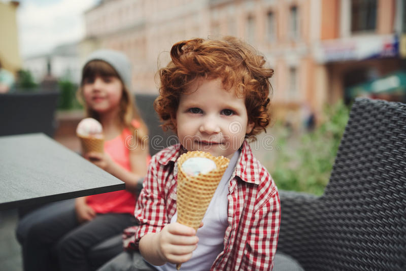 Two cute hipsters eating icecream stock photos