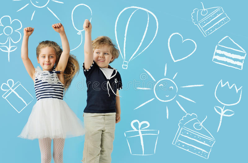 Two cute kids over the drawings background. Two cute children over the drawings background royalty free stock photos