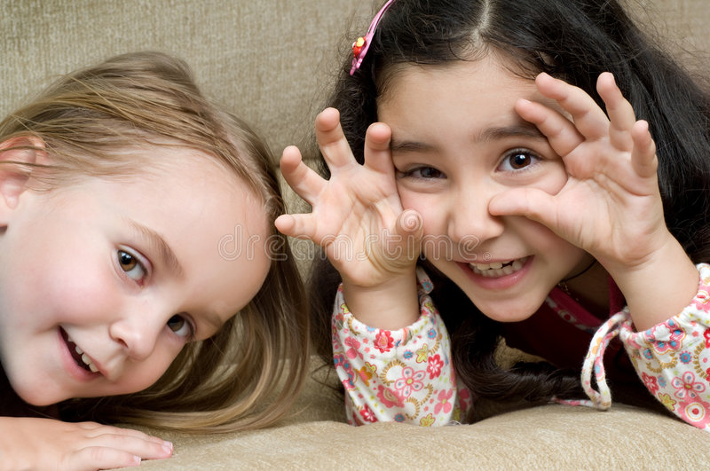 Download Two cute little girls stock photo. Image of lying, hair - 6679920
