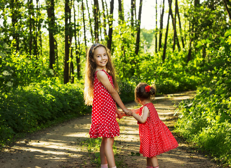 Two cute little girls having fun at summer day. Cute little girls having fun at summer day royalty free stock photo