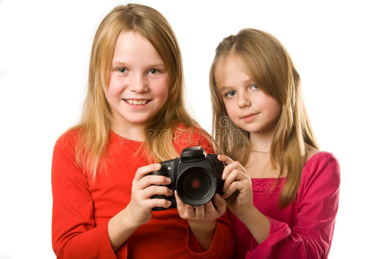 Two cute little girls with photo camera royalty free stock photo