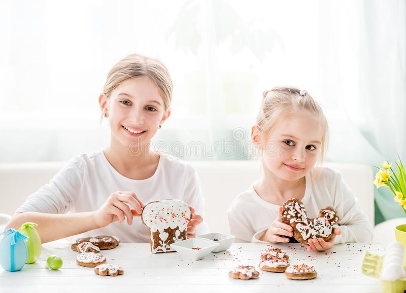 Little girls showing homemade Easter cookies stock images