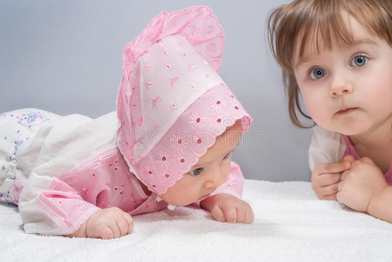 Two cute sisters stock photos