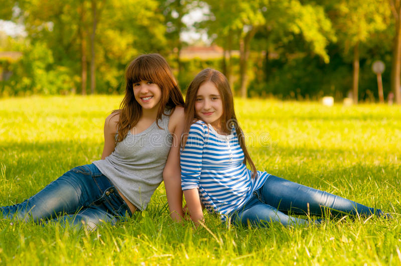 Download Two Cute Smiling Teenage Girls Sitting On The Gras Stock Photo - Image: 26549274