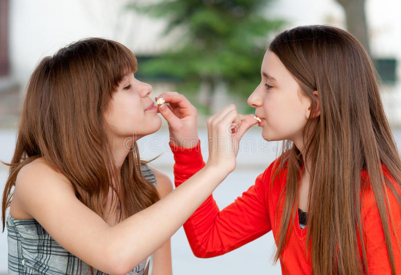 Download Two Cute Teenage Girls Feeding Each Other Stock Image - Image of together, having: 24231881