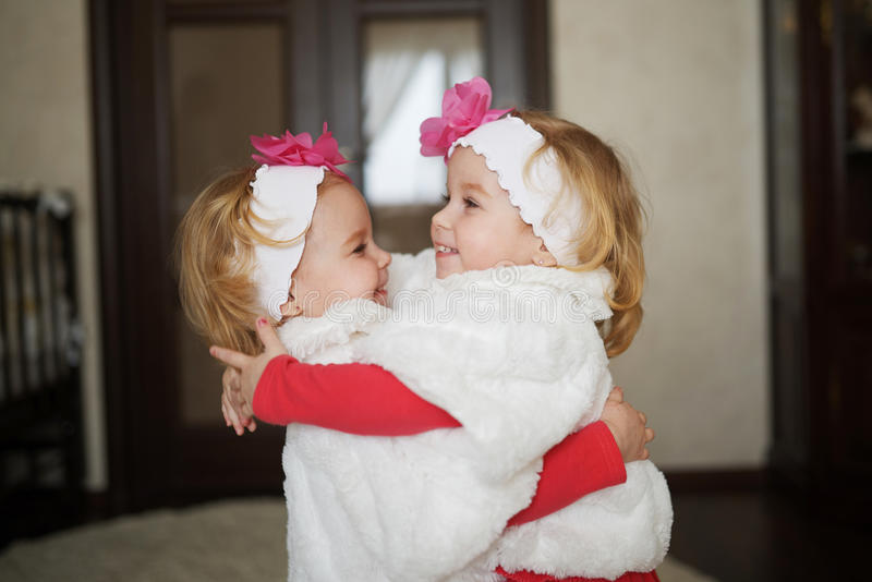 Two cute twin girls royalty free stock images