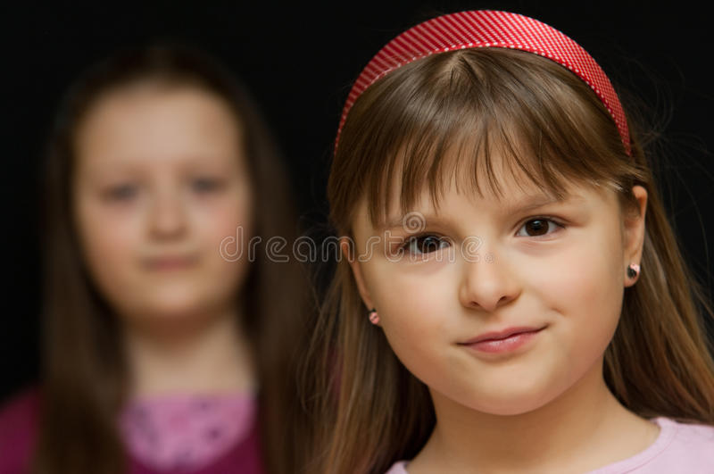 Two cute young girls stock photo