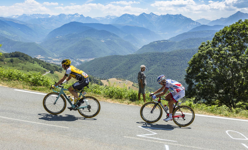Two Cyclists on Col d'Aspin - Tour de France 2015. Col D'Aspin,France- July 15,2015: The cyclists Tom Leezer of Lotto NL-Jumbo Team and Sebastien Chavanel of FDJ stock photo