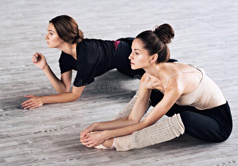 Two dancers friends practice in dance studio. Photo stock image