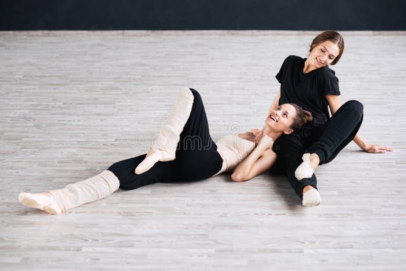 Two dancers friends practice in dance studio. Photo stock images