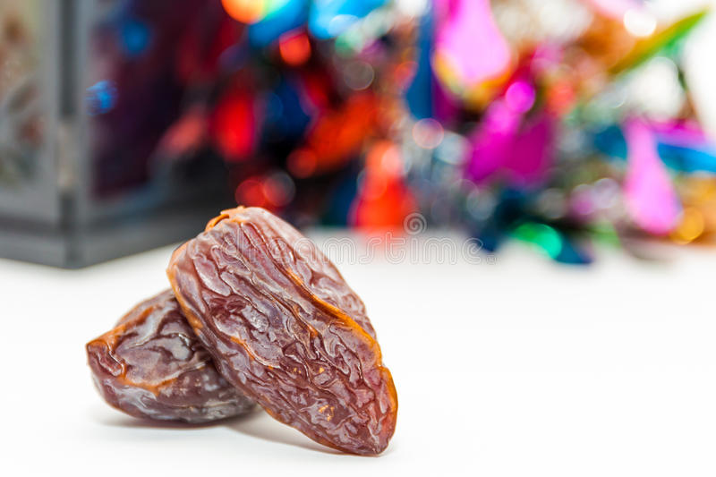 Two date fruits.Ramadan Eid concept. Two date fruits on colorful background.Ramadan Eid concept royalty free stock photo