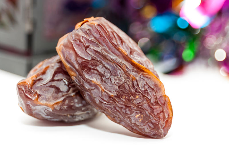 Two date fruits.Ramadan Eid concept. Two date fruits on colorful background.Ramadan Eid concept stock photos