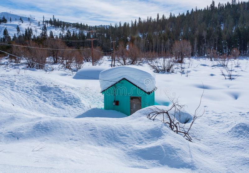 After two days of heavy snow little cabin is snowed in. Trying to get to this cabin was impossible. This was two days of snow fall in the high Sierra mountains royalty free stock photos