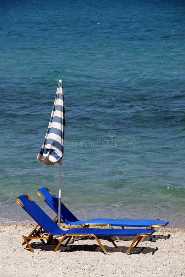 Download Two Deckchairs On The Beach Stock Photo - Image: 31369750