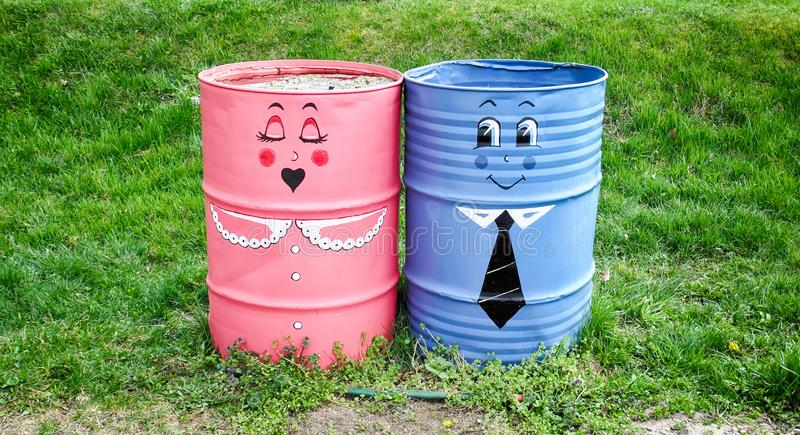 Two decorated metal barrels stock image
