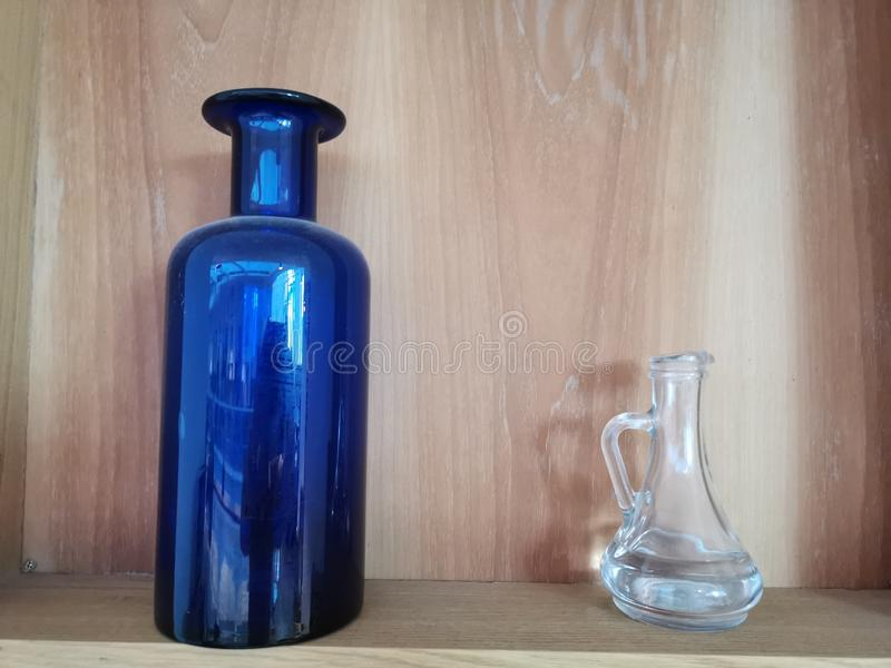Two decorative bottles - blue and transparent royalty free stock photos